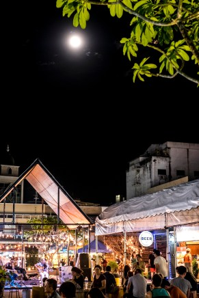Full moon by the night market