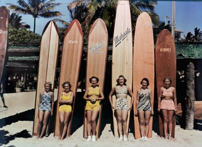 Women pose in front of their surfboards on Waikiki beach in Honolulu, November 1938.