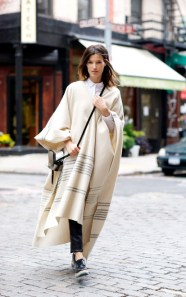 http://www.vogue.com/869506/the-verdict-is-in-extra-long-ponchos/
