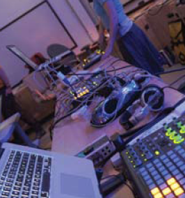 An array of laptops and MIDI controllers being played that night