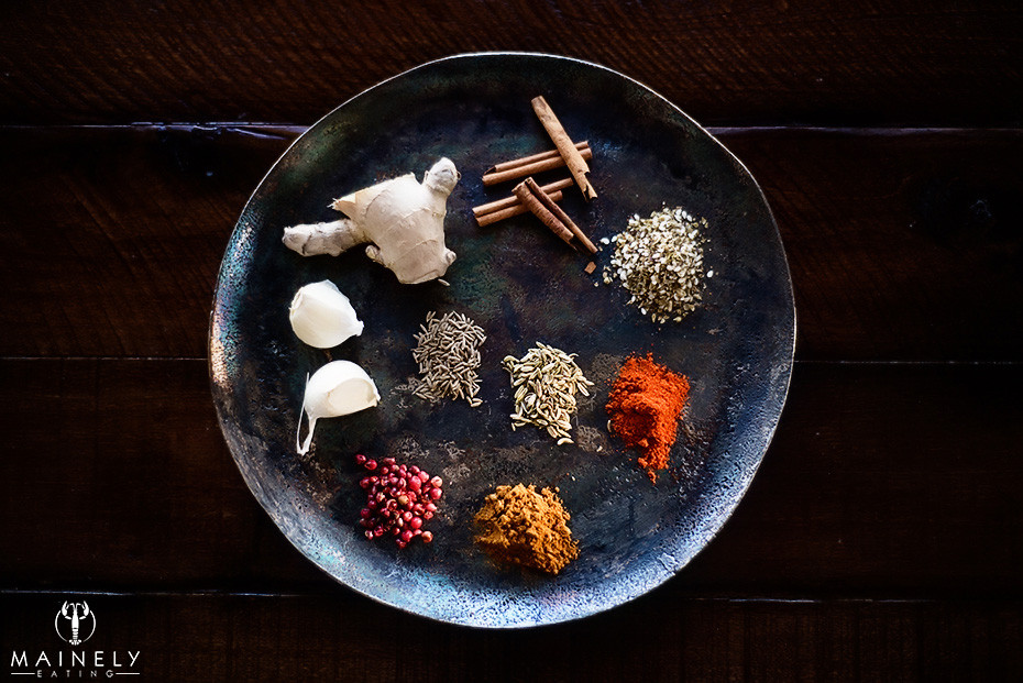 A selection of colorful herbs and spices for a fragrant lamb shank recipe - inspiration from Morocco and North Africa