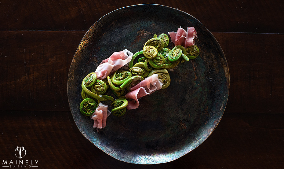 Fiddleheads cooked in a lemon butter with prosciutto by MainelyEating.com