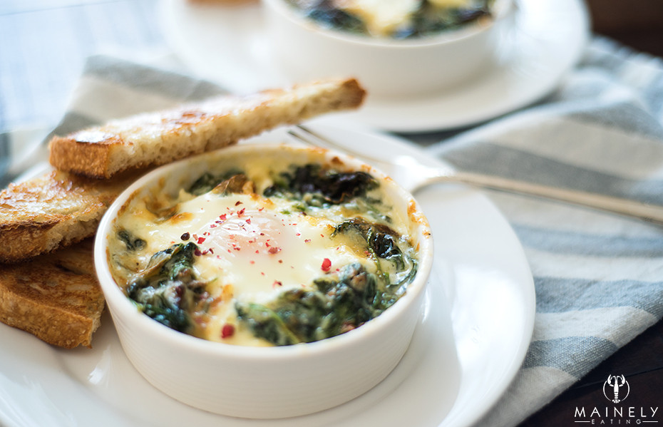 Eggs en cocotte, eggs nestled in a creamy spinach and ham casserole