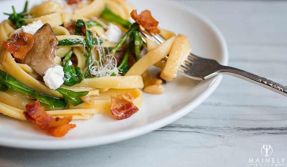 Mouthwatering pasta recipe with nutty pan roasted mushrooms, peppery arugula, creamy goat cheese and crispy bacon.