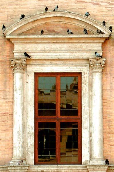 Roman Renaissance window with birds