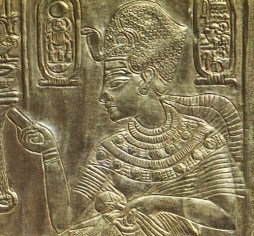 A closeup of Tutankhamun from his golden shrine with mandrake elements clearly visible in his broad collar