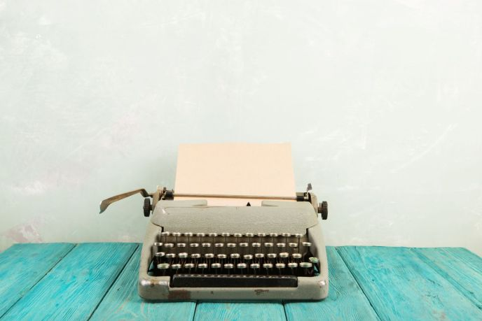 Typewriter n a teal wooden surface