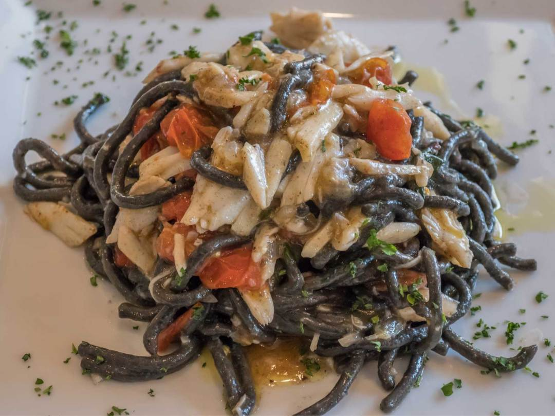 squid ink spaghetti with crab at La Tavola in Little Italy Baltimore Maryland