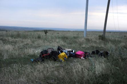 Luggages are pictured on July 17, 2014 on the site of the crash of the malaysian airliner carrying 295 people from Amsterdam to Kuala Lumpur, near the town of Shaktarsk, in rebel-held east Ukraine. Pro-Russian rebels fighting central Kiev authorities claimed on Thursday that the Malaysian airline that crashed in Ukraine had been shot down by a Ukrainian jet. The head of Ukraine's air traffic control agency said Thursday that the crew of the Malaysia Airlines jet that crashed in the separatist east had reported no problems during flight. AFP PHOTO/DOMINIQUE FAGET (Photo credit should read DOMINIQUE FAGET/AFP/Getty Images)