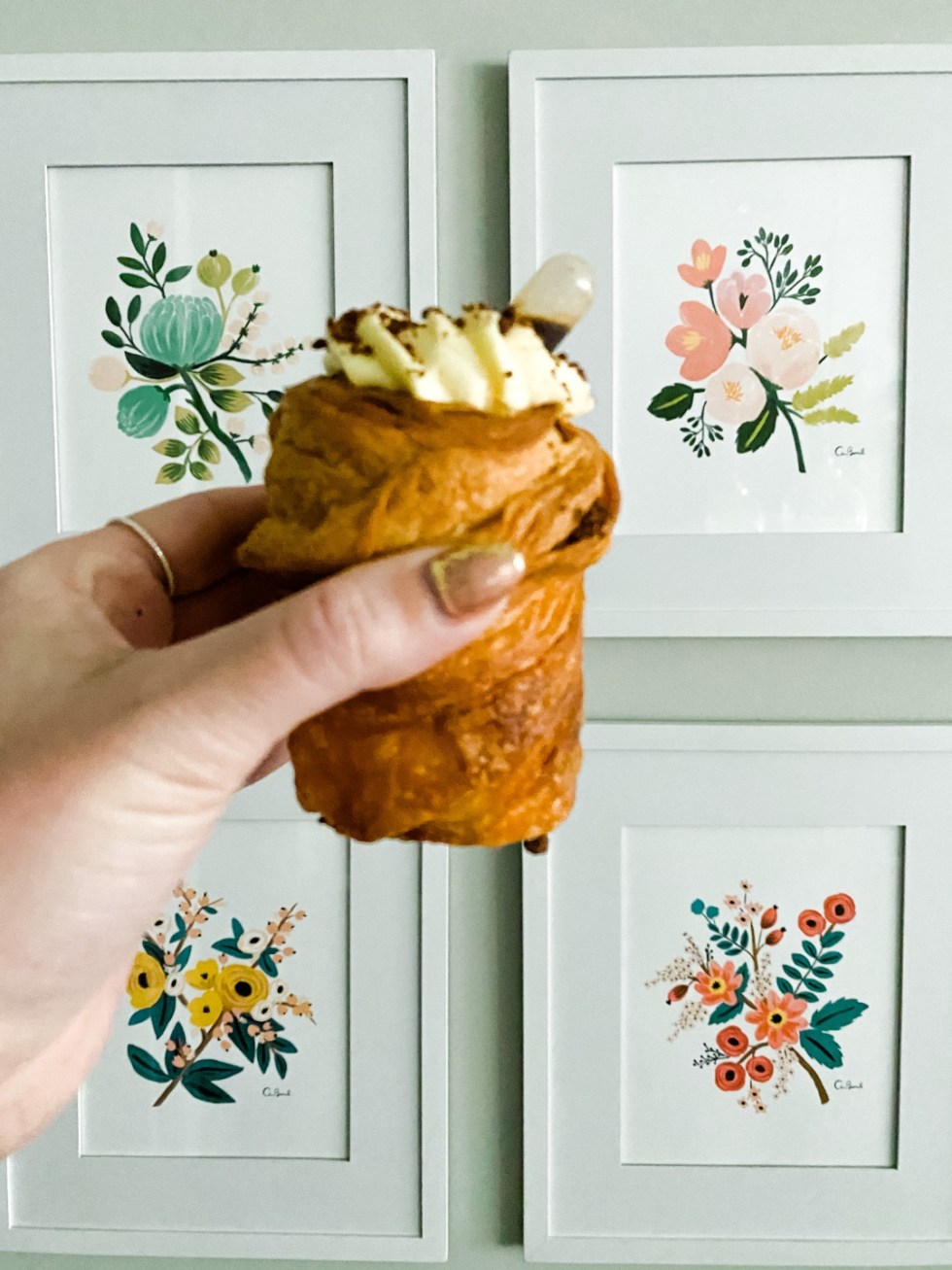 Girls Day Out in Raleigh by popular NC lifestyle blog, I'm Fixin' To: image of a woman holding a pastry in her hand.