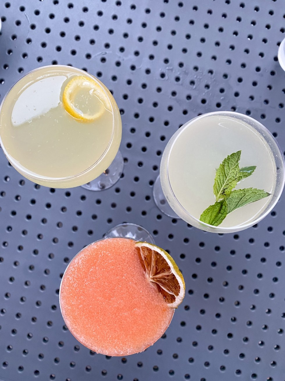 23 Awesome Things To Do in Durham - I'm Fixin' To - @imfixintoblog | Things to do in Durham by popular NC travel blog, I'm Fixin' To: image of three different cocktail drinks.