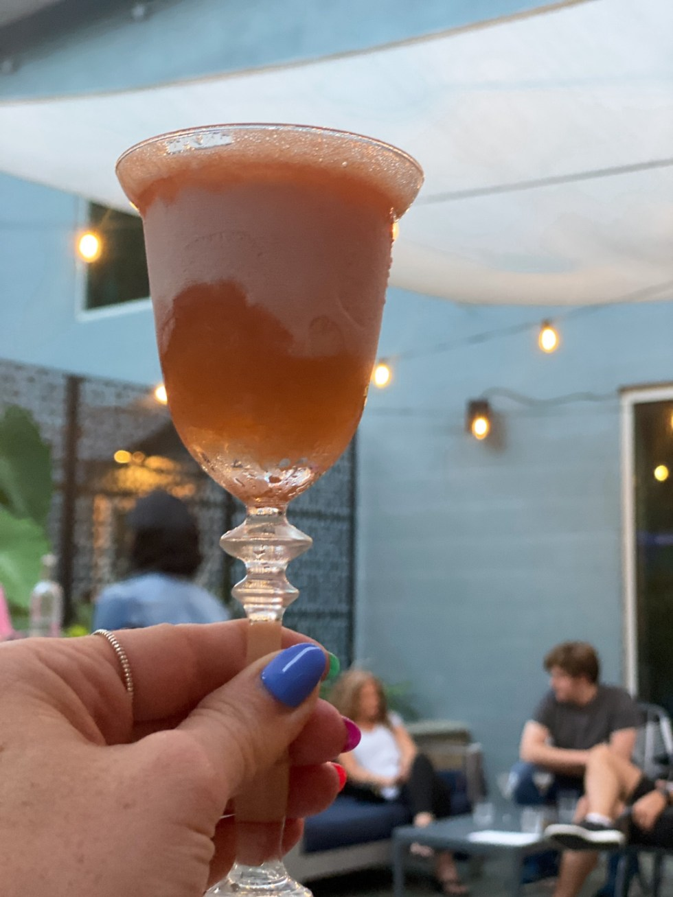 23 Awesome Things To Do in Durham - I'm Fixin' To - @imfixintoblog | Things to do in Durham by popular NC travel blog, I'm Fixin' To: image of a woman holding a cocktail drink in her hand.