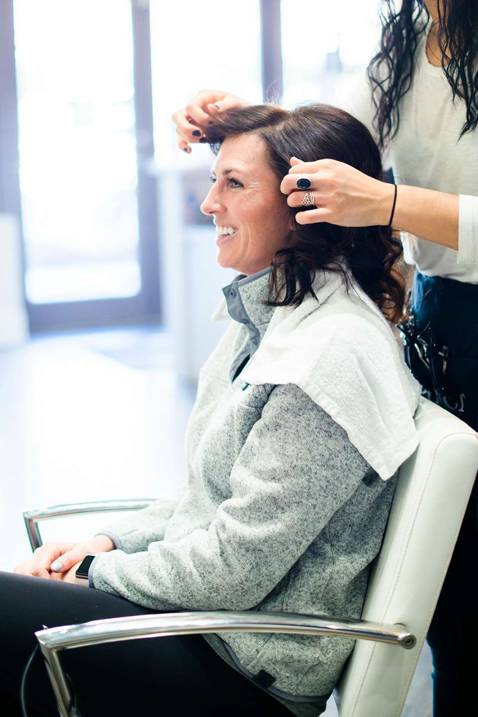The Ultimate Girls' Day Out in Raleigh - I'm Fixin' To - @imfixintoblog | Girls Day Out In Raleigh by popular NC lifestyle blog, I'm Fixin' To: image of a woman getting her hair done at a hair salon.