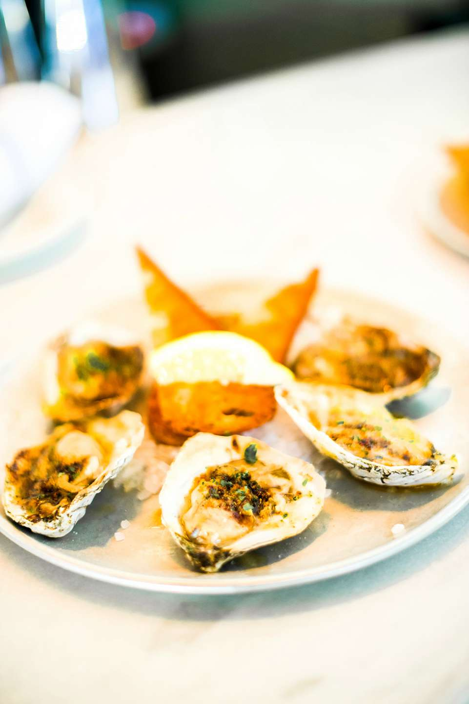Raleigh Oyster Crawl - I'm Fixin' To - @mbg0112 | Raleigh Oyster Crawl by popular North Carolina blog, I'm Fixin' To: image of oysters on a white ceramic plate.