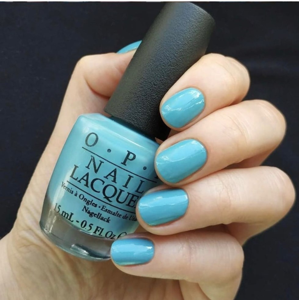 Top 10 Best Summer Nail Polish Colors by popular North Carolina blog, I'm Fixin' To: image of a manicured hand with OPI Can't Find My Czechbook on the fingernails.