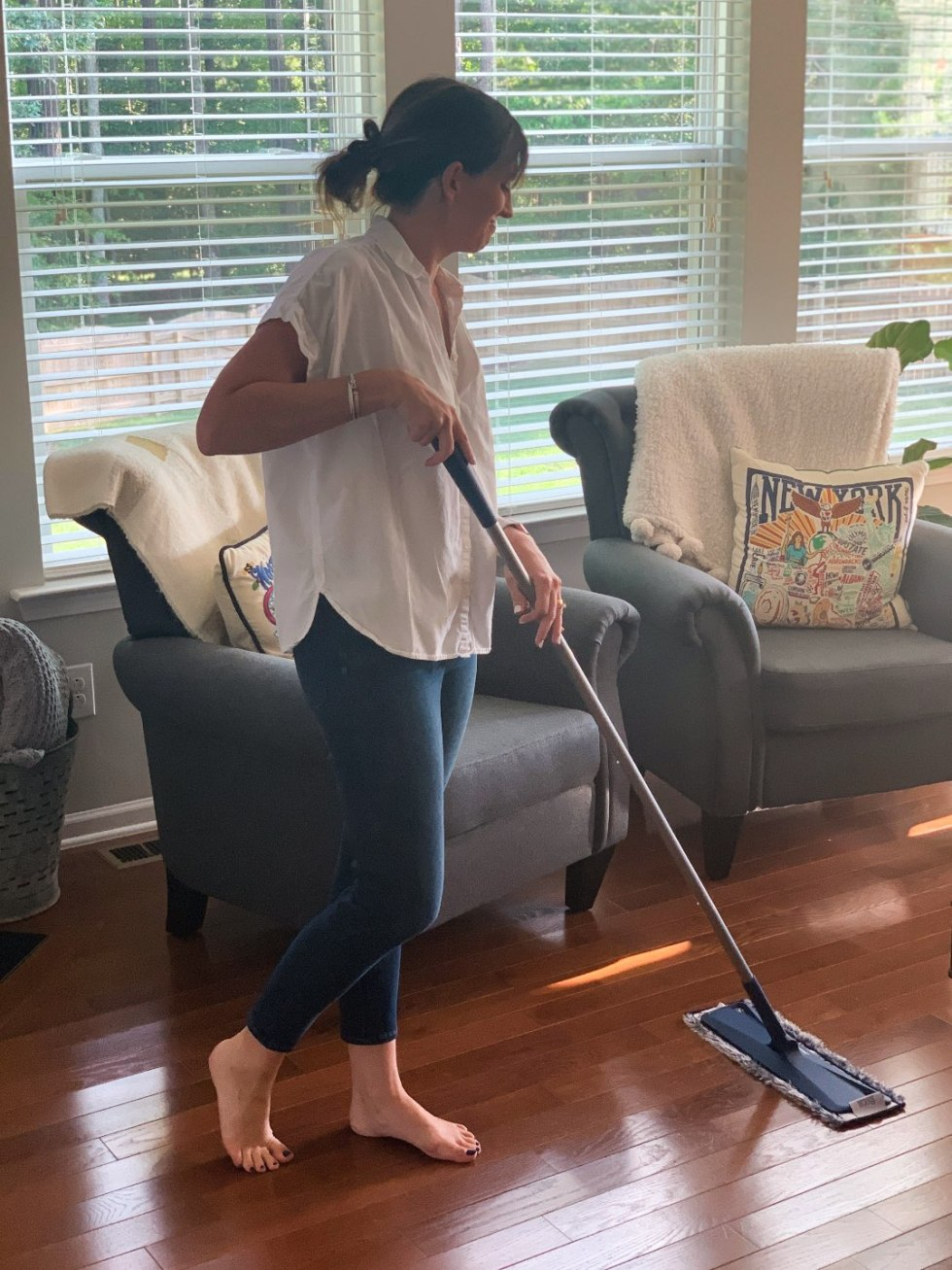 Keeping Our Floors Clean with Bona Essentials - I'm Fixin' To - @mbg0112 | Keeping Our Floors Clean with Bona Essentials by popular lifestyle blog, I'm Fixin' To: image of a woman moping her floor with a Bona Essentials mop.