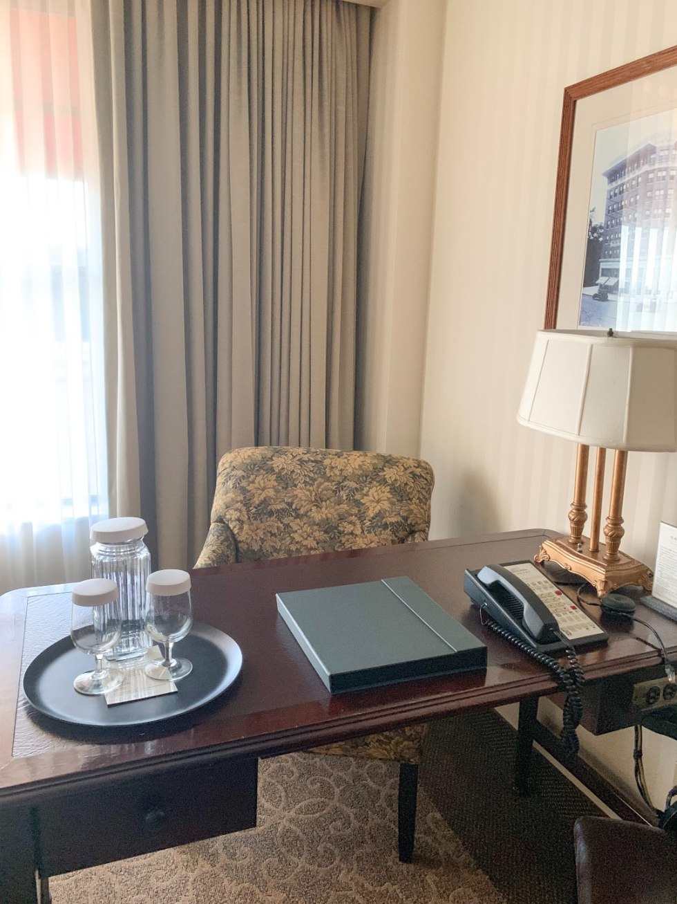 A Night at the O.Henry Hotel In Greensboro, NC - I'm Fixin' To - @mbg0112 | A Night at the O.Henry Hotel In Greensboro, NC by popular North Carolina blog, I'm fixin' To: image of a desk in a king room at the O. Henry Hotel.
