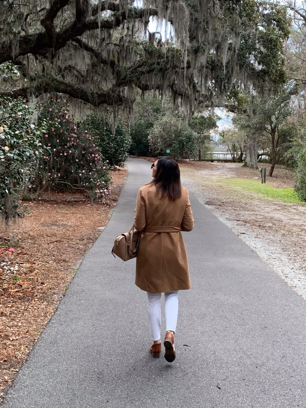 One Year Since  Hurricane Florence in North Carolina and How to Help Ocracoke by popular North Carolina blog, I'm Fixin' To: image of a woman walking under and oak tree with Spanish Moss growing on it.