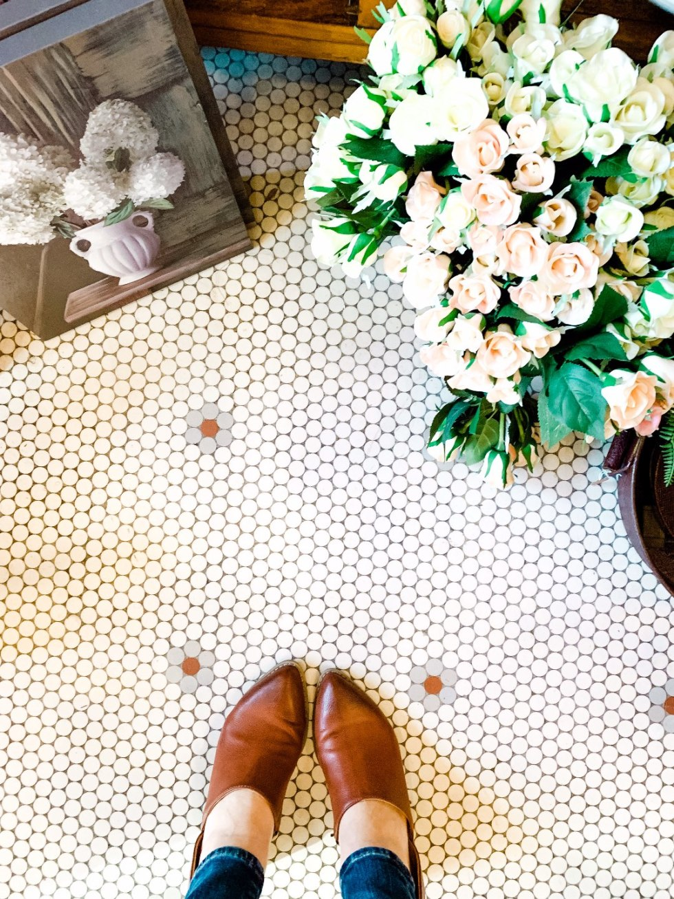 Eastern North Carolina Travel Guide: Top 10 Things to Do in Goldsboro NC by popular North Carolina blog, I'm Fixin' To: image of a penny tile floor and bucket of roses.