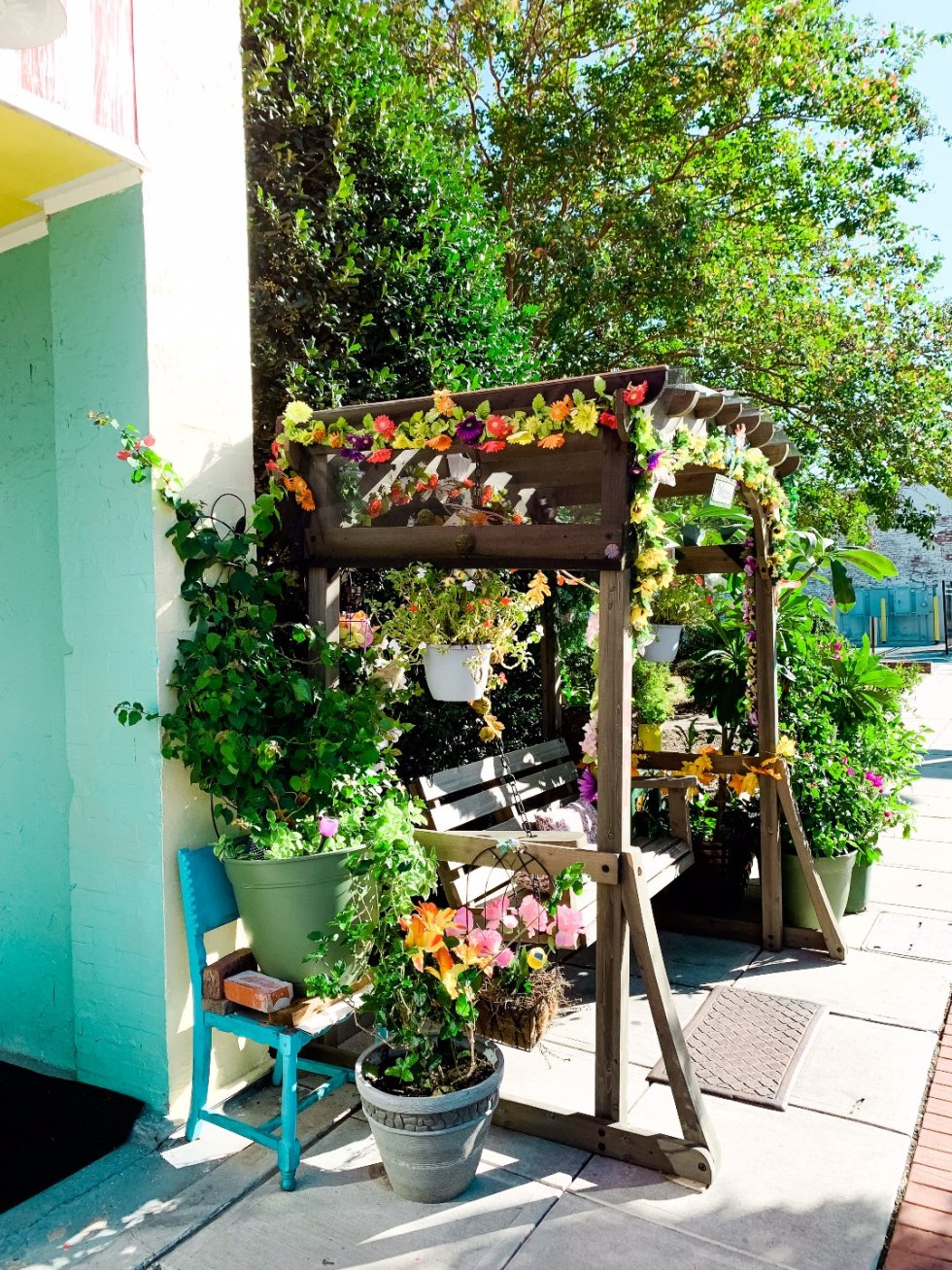 Eastern North Carolina Travel Guide: Top 10 Things to Do in Goldsboro NC by popular North Carolina blog, I'm Fixin' To: image of a decorated bench swing.