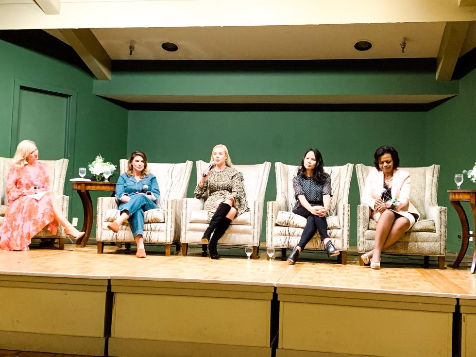 Eastern North Carolina Travel Guide: Top 10 Things to Do in Goldsboro NC by popular North Carolina blog, I'm Fixin' To: image of a group of women sitting in armchairs on a stage.