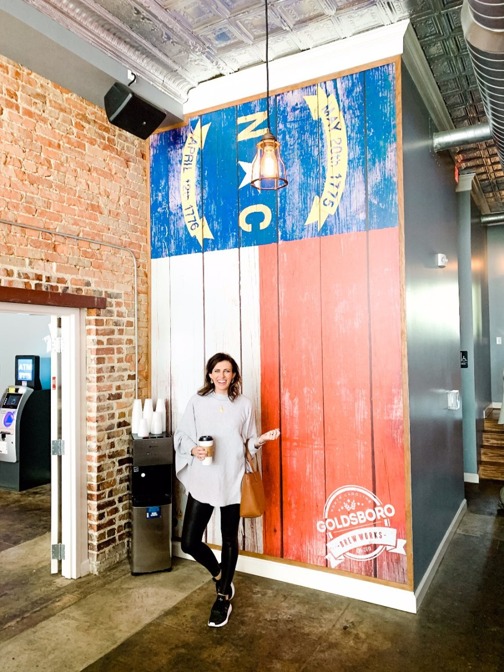 Eastern North Carolina Travel Guide: Top 10 Things to Do in Goldsboro NC by popular North Carolina blog, I'm Fixin' To: image of a woman wearing Spanx faux leather leggings at Goldsboro brew works.