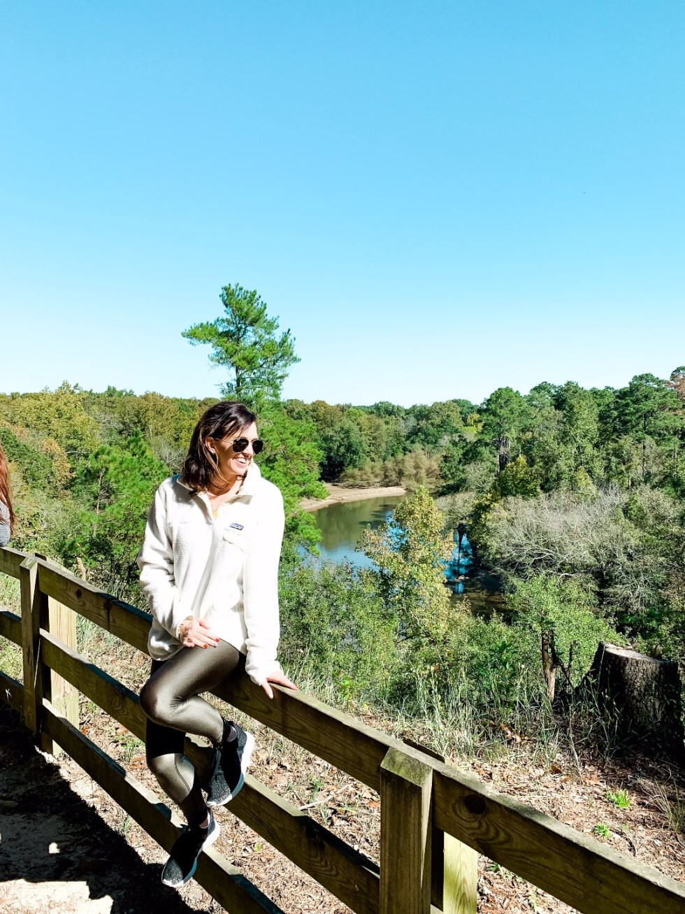 Eastern North Carolina Travel Guide: Top 10 Things to Do in Goldsboro NC by popular North Carolina blog, I'm Fixin' To: image of a woman outside at Neuse state park.