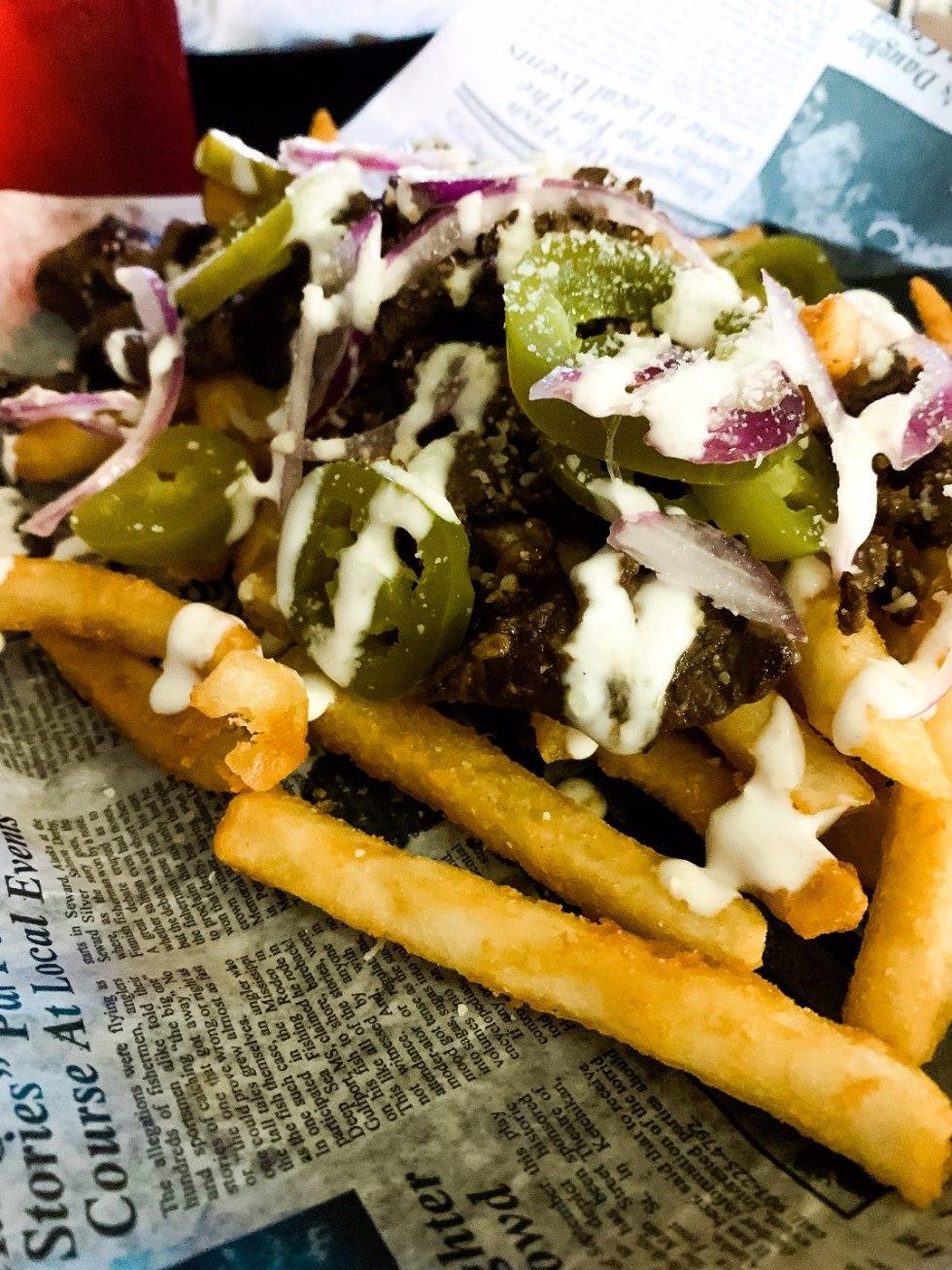 Eastern North Carolina Travel Guide: Top 10 Things to Do in Goldsboro NC by popular North Carolina blog, I'm Fixin' To: image of food at Jay's Sushi and Burger Bar.