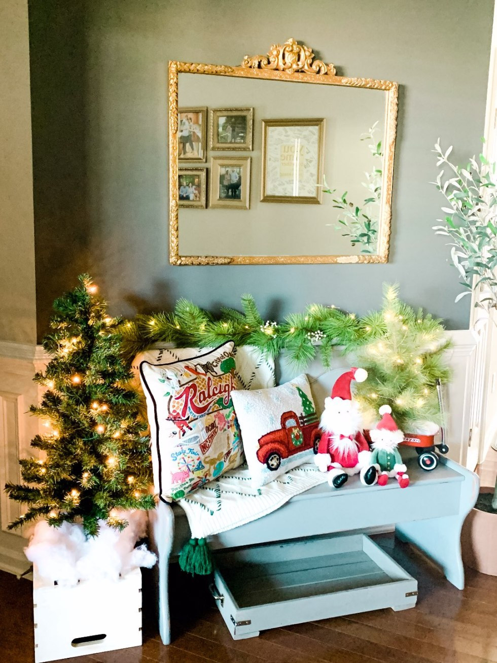 Holiday Home Decor Tour - I'm Fixin' To - @mbg0112 | Holiday Home Decor Tour by popular North Carolina life and style blog, I'm Fixin' To: image of a home foyer decorated with Bench & Mirror from The Cary Cottage, 3 Foot Pre-Lit Tree, Small Tree, Jelly Cat Santa, Jelly Cat Elf Hearth & Hand Garland, Catstudio Raleigh Pillow, and Embroidered Pillow.