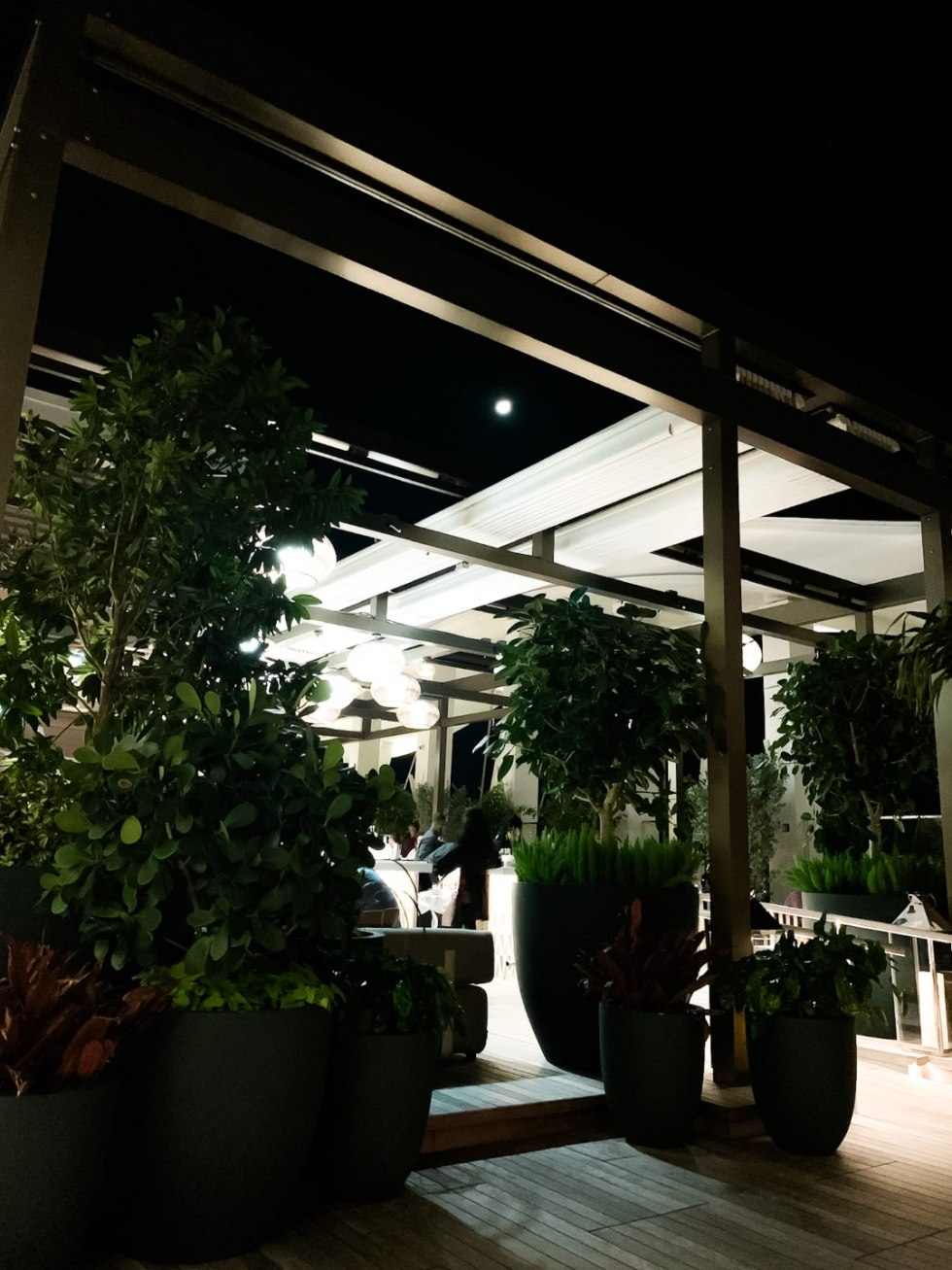 Warming Up in the Bahamas: the Best Things to Do at Baha Mar - I'm Fixin' To - @mbg0112 | Warming Up in the Bahamas: the Best Things to Do in Baha Mar by popular North Carolina travel blog, I'm Fixin' To: image of a lit outdoor patio at night.