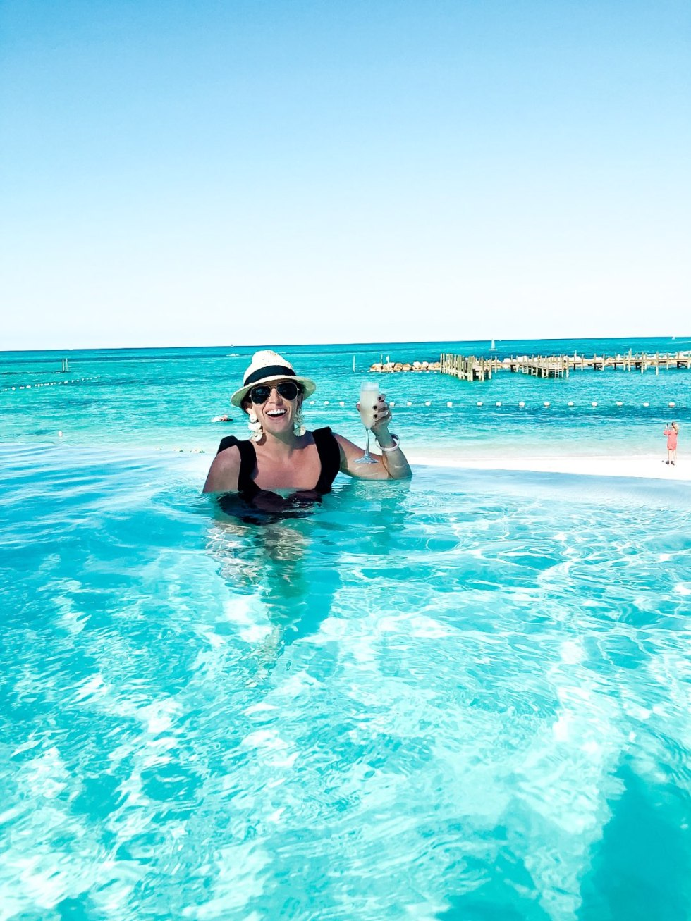 Warming Up in the Bahamas: the Best Things to Do at Baha Mar - I'm Fixin' To - @mbg0112 | Warming Up in the Bahamas: the Best Things to Do in Baha Mar by popular North Carolina travel blog, I'm Fixin' To: image of a woman in a an infinity pool.