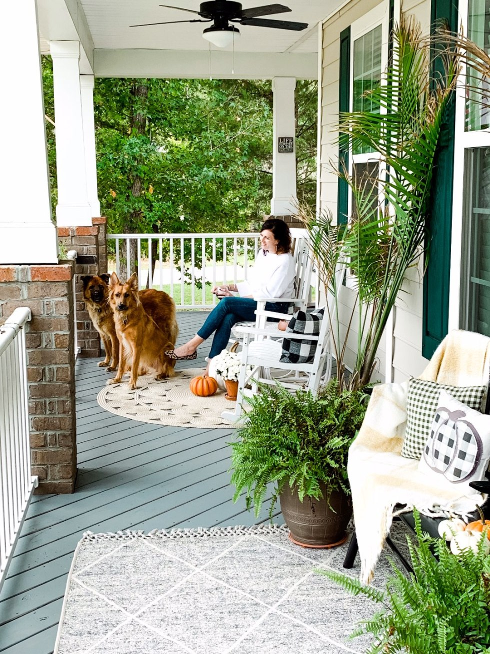 How to Set Healthy Boundaries with Friends: 8 Essential Tips - I'm Fixin' To - @mbg0112 | How to Set Healthy Boundaries with Friends: 8 Essential Tips by popular NC life and style blog, I'm Fixin' To: image of a woman sitting on her front porch with her two dogs.