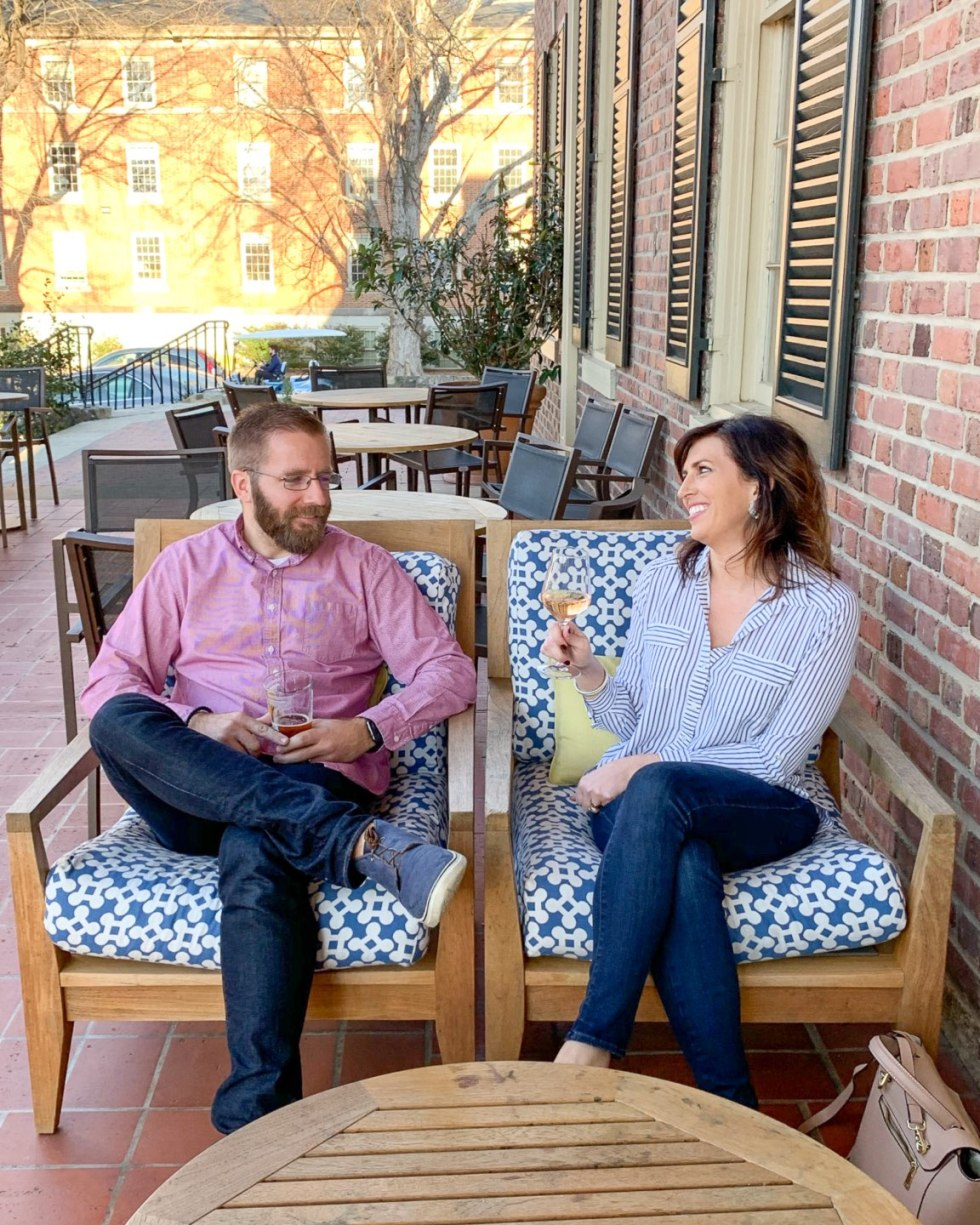 Top 10 Most Popular Blog Posts of 2019 - I'm Fixin' To - @mbg0112 | Top 10 Most Popular Blog Posts of 2019 by popular North Carolina life and style blog, I'm Fixin' To: image of a man and woman sitting outside on a patio in Chapel Hill.