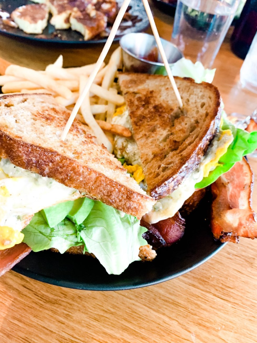 Where to Get Brunch in Raleigh: the 7 Best Spots - I'm Fixin' To - @mbg0112 | Brunch in Raleigh by popular Raleigh blog, I'm Fixin To: image of a Whiskey Kitchen sandwich.