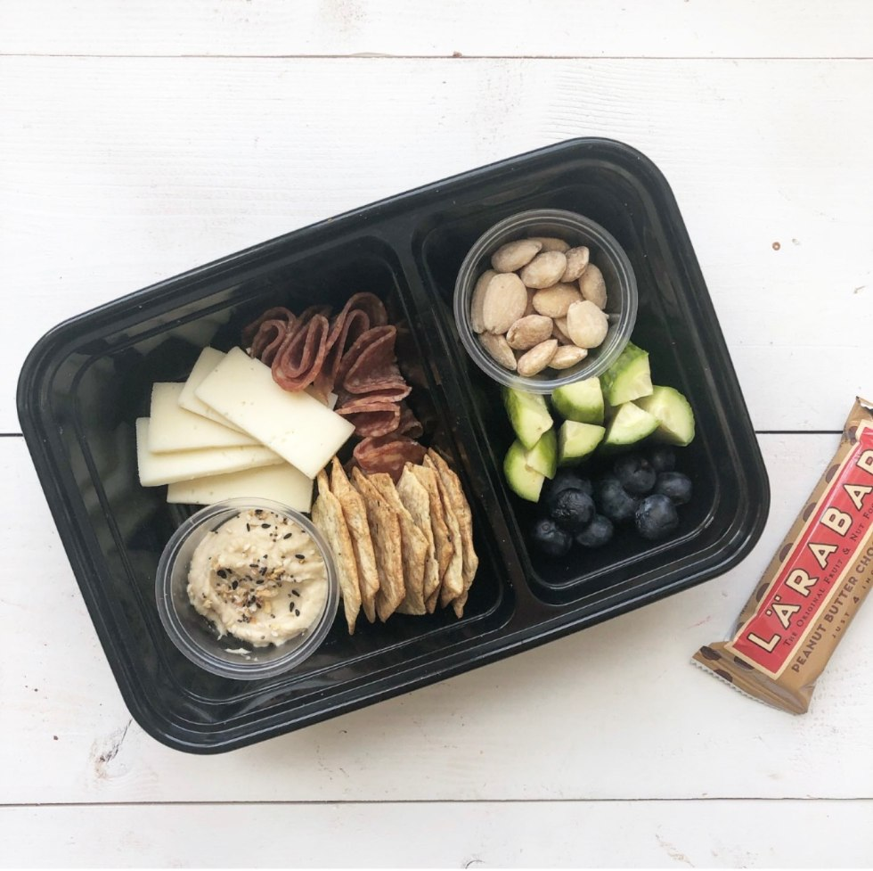 The Empowered Women Series: On the Go Lunch Ideas for Teachers with Kayte Fry by popular NC life and style blog, I'm Fixin To: image of Walmart Mainstays Meal Prep Food Storage Container with cheese, salami, hummas, crackers, nuts, cucumbers, blueberries, and a Larabar.