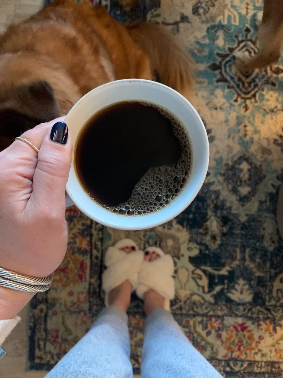 The Empowered Women Series: Three Tips for Handling Stress during COVID-19 with Bethany Hauch - I'm Fixin' To - @mbg0112 | Stress Management Tips by popular NC lifestyle blog, I'm Fixin' To: image of a woman wearing white fuzzy slippers and holding a mug of coffee.