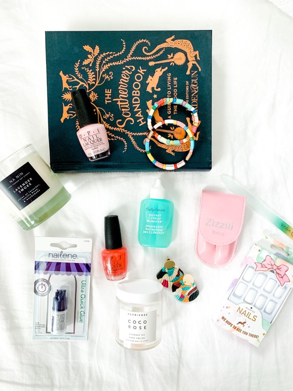 How to Master the Perfect Manicure at Home - I'm Fixin' To - @mbg0112 |  Home Manicure Essentials by popular NC beauty blog, I'm Fixin' To: image of OPI nail polish, fake nails, naileen ultra quick glue earrings, Sally Hassen Instant Cuticle Remover, Herbivore Coco Rose coconut oil body polish, multi color stretch bracelets, Retinol anti-aging hand treatment, and Burt's Bees foot cream.