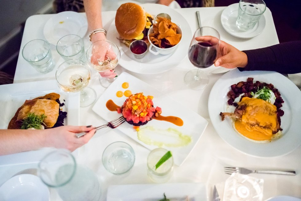 Best North Carolina Restaurants by popular N.C. blog, I'm Fixin' To: image of people eating food at Spring House restaurant.