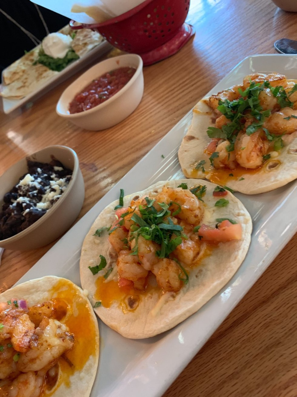 The 20 North Carolina Restaurants I Can't Wait to Visit after Quarantine - I'm Fixin' To - @mbg0112 | Best North Carolina Restaurants by popular N.C. blog, I'm Fixin' To: image of shrimp tacos at Gonza Tacos y Tequila restaurant.