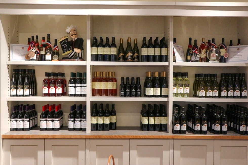 Celebrate North Carolina Wines during NC Wine Month - I'm Fixin' To - @mbg0112 | North Carolina Wine by popular North Carolina blog, I'm Fixin' To: image of various North Carolina wines on shelves.