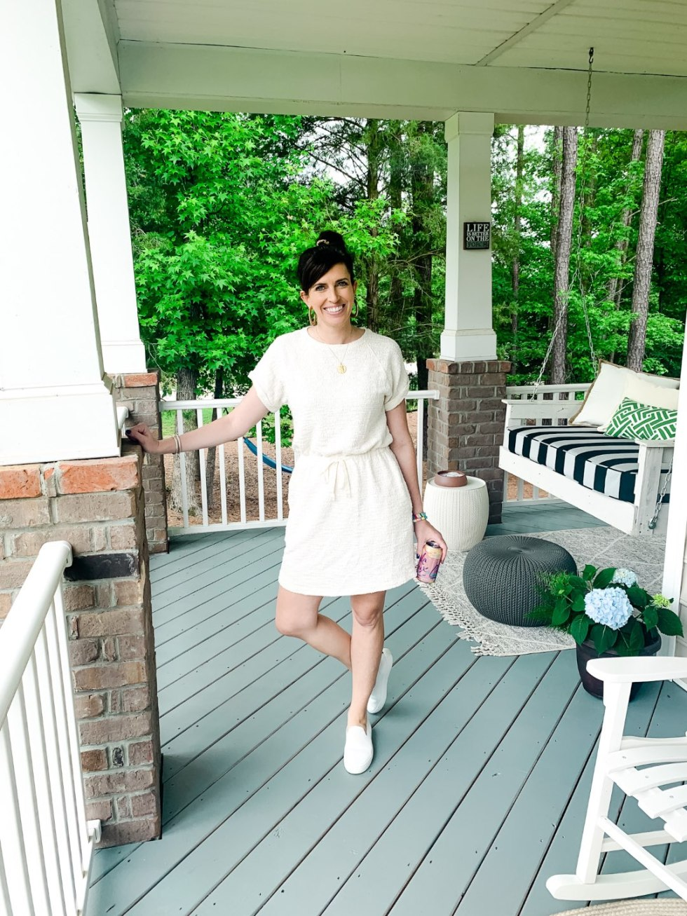 5 Stylish Teleworking Outfits for Women - I'm Fixin' To - @mbg0112 | Teleworking Outfits for Women by popular North Carolina fashion blog, I'm Fixin' To: image of a woman standing on her front porch and wearing a Loft Lou + Grey TWEEDKNIT DRAWSTRING DRESS and Rothy's shoes.