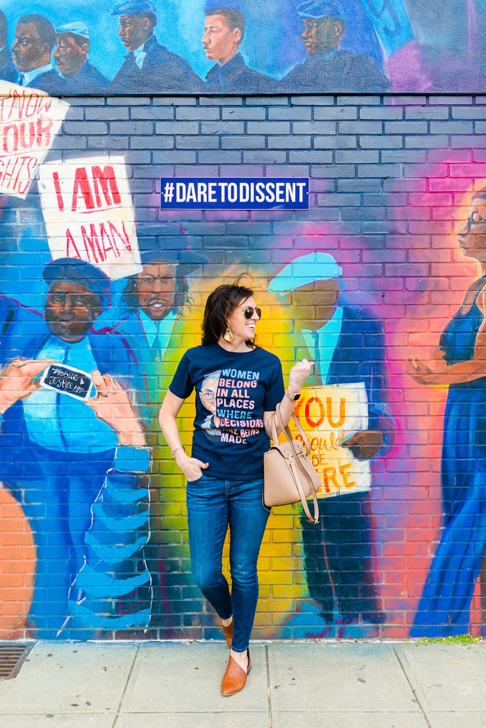 How to Make Social Change by popular North Carolina lifestyle blog, I'm Fixin' To: image of a woman wearing a Ruth Bader Ginsburg t-shirt and standing in front of a #daretodissent wall mural.