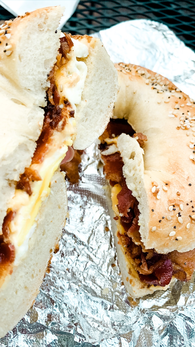 Weekend in Charlotte by popular N.C. travel blog, I'm Fixin' To: image of a bagel sandwich at Poppy's Bagels.