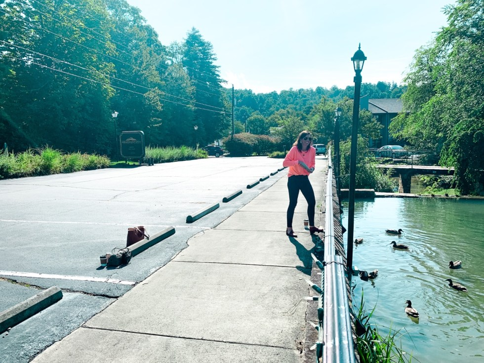 Where to Stay in Blowing Rock: a Meadowbrook Inn Review - I'm Fixin' To - @mbg0112 | Meadow Brook Inn Blowing Rock by popular N.C. travel blog, I'm Fixin' To: image of a woman feeding ducks at Meadow Brook Inn.