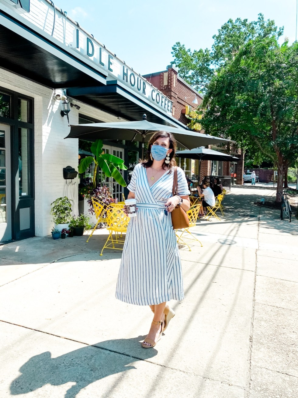 Favorite Purchases by popular N.C. life and style blog, I'm FIxin' To: image of a woman standing outside Idle Hour Coffee and wearing a Gap striped dress.