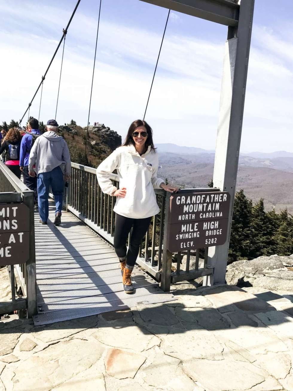 Local Love: 10 Best Places to Photograph in North Carolina - I'm Fixin' To - @mbg0112 | Best Places to Photography in North Carolina by popular N.C. lifestyle blog, I'm Fixin' To: image of a woman at the Mile High Bridge at Grandfather Mountain.
