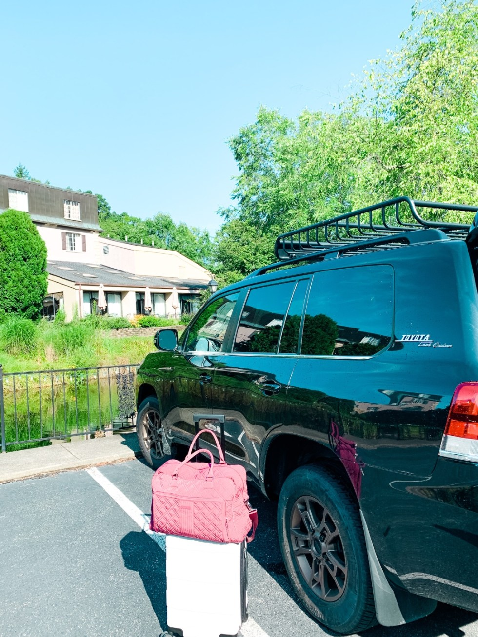 Meadow Brook Inn Blowing Rock by popular N.C. travel blog, I'm Fixin' To: image of a black Toyota parked at Meadow Brook Inn.