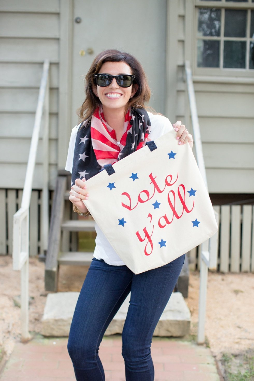 Civic Engagement Fashion Top Picks for Women - I'm Fixin' To - @mbg0112 | Civic Engagement by popular N.C. fashion blog, I'm Fixin' To: image of a woman wearing a American Flag scarf, white t-shirt, jeans, and holding a Draper James Vote Y'all tote.