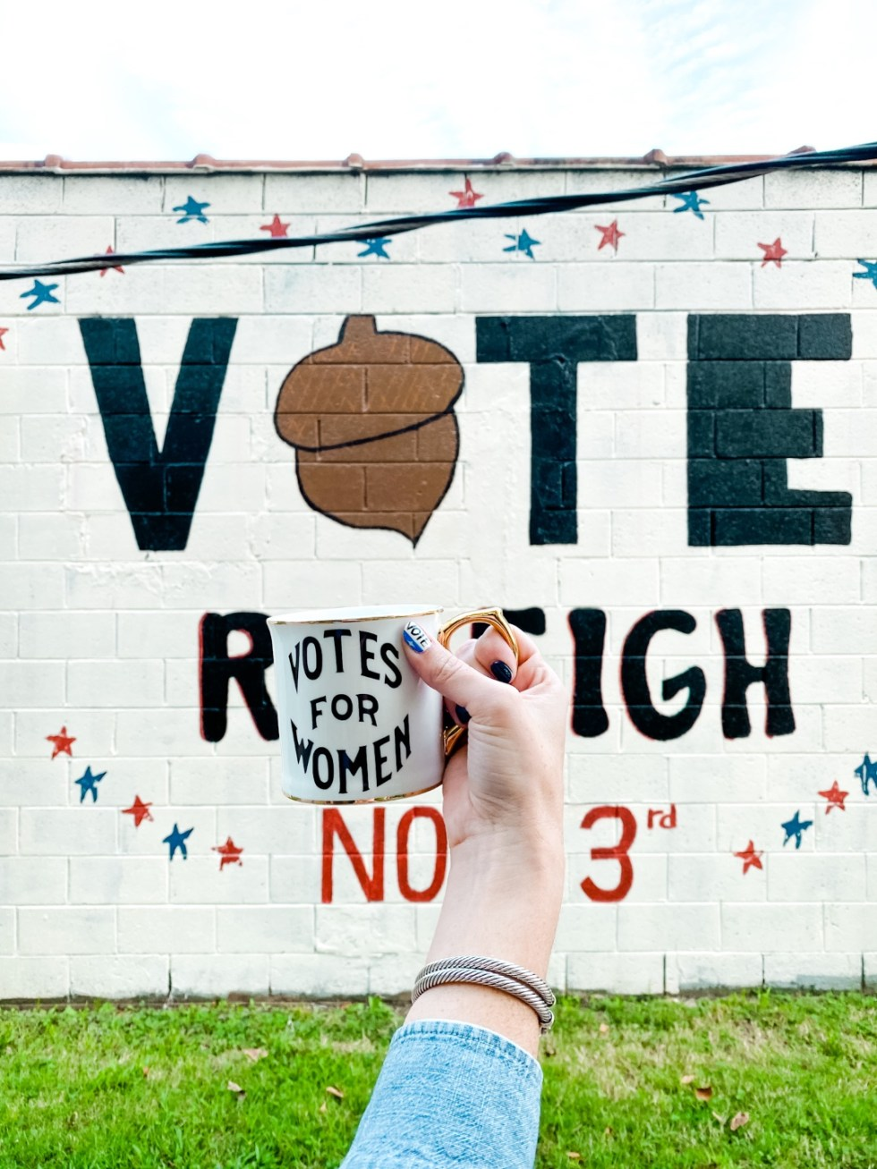 Civic Engagement Fashion Top Picks for Women - I'm Fixin' To - @mbg0112 | Civic Engagement by popular N.C. fashion blog, I'm Fixin' To: image of a woman holding a 'Votes for Women' mug.