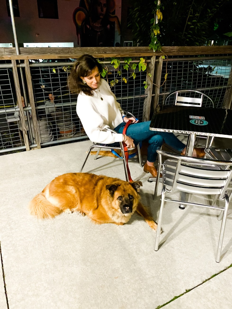 A Casual Weekend in Asheville: the Best Things to Do with your Dogs - I'm Fixin' To - @mbg0112   Weekend In Asheville by popular NC travel blog, I'm Fixin' To: image of a woman sitting outside with her dog at a brewery.